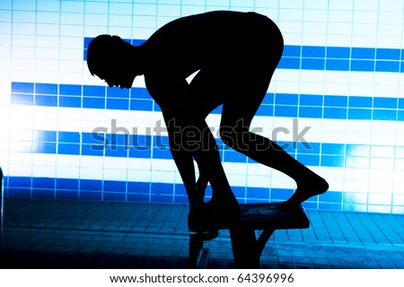 silhouette of player on starting platform on swimming pool