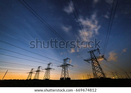 Silhouette of power lines on the background of beautiful clouds sky at dusk.  #669674812
