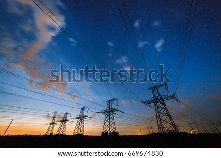 Silhouette of power lines on the background of beautiful clouds sky at dusk.  #669674830