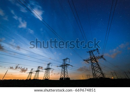 Silhouette of power lines on the background of beautiful clouds sky at dusk.  #669674851