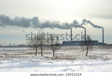 silhouette of power plant and smoke - stock photo