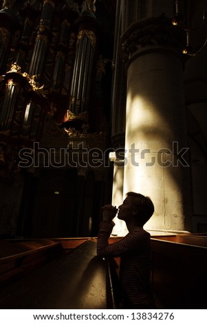 silhouette of praying woman.