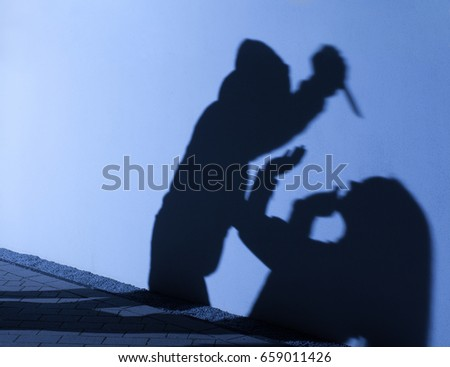 silhouette of robbery or murder attack
