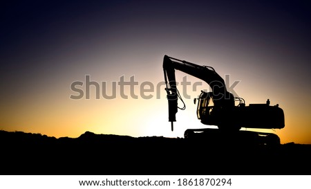 Silhouette of rock breaker with hydraulic  hammer at sunset in oilfield Photo stock ©
