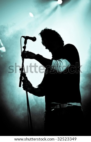 silhouette of rock singer live on stage