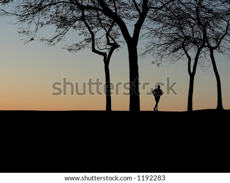 Silhouette of runner at dawn