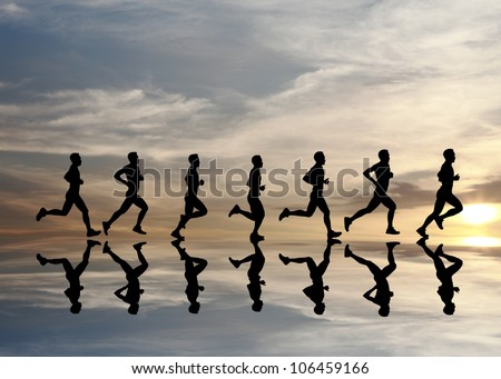 Silhouette of runner with reflection during a surreal dramatic sunset.