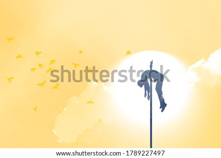 Silhouette of sacrificial victim impaled on a stake against a setting sun for Halloween concept.  Сток-фото ©