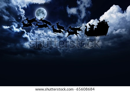 silhouette of Santa sleigh and reindeer in night sky with full moon