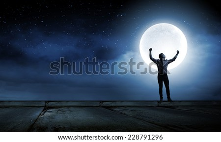 Silhouette of screaming man celebrating success