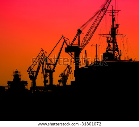 Silhouette of sea port cranes in the morning, St.Petersburg, Russia