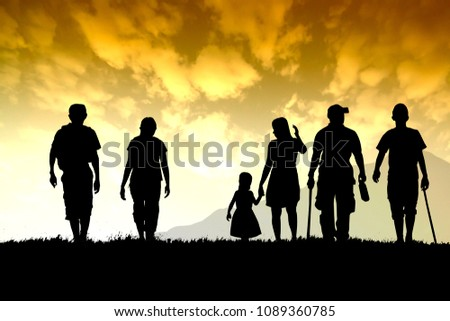 Silhouette of shadow nature meadow and mountain with family group walk for travel under orange sky. #1089360785