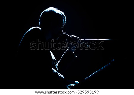 Silhouette of singer with piano