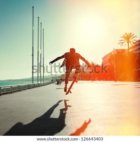 silhouette of skateboarder...