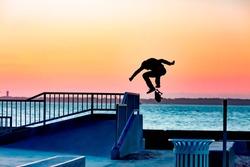 silhouette of skater at skate park