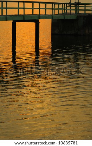Silhouette of small pier at sunset