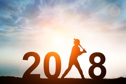 Silhouette of Softball Player in 2018 text for Happy New year Concept