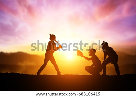 Silhouette of Softball Player on Sunset Background