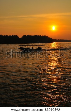 silhouette of speed boat running in the river of Bangpakong, Ampawa, Thailand.