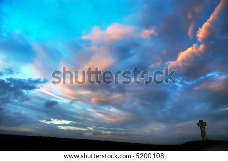 silhouette of stone cross on the sky background