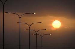 Silhouette of street lights during beautiful sunset