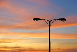 silhouette of streetlight with beautiful twilight background