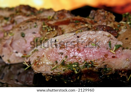 Silhouette of summer garden BBQ roast isolated against fire background