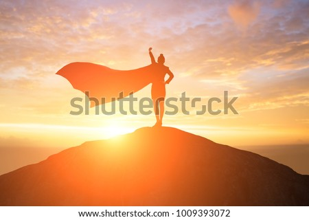 silhouette of super business woman look somewhere on the mountain