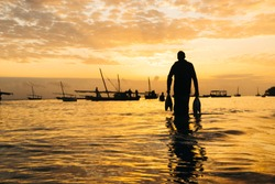 Silhouette of Sword Fish and African Fisherman at Nungwi/Zanzibar Tanzania