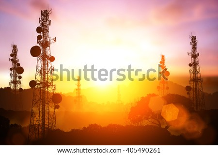 silhouette of Telecommunication mast television antennas on sunset and flare light #405490261