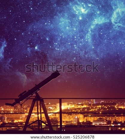 Silhouette of Telescope on background stars and night city. Elements of this image furnished by NASA.
