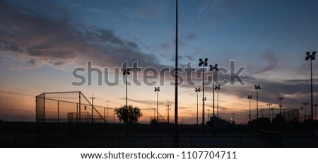 silhouette of tennis court #1107704711