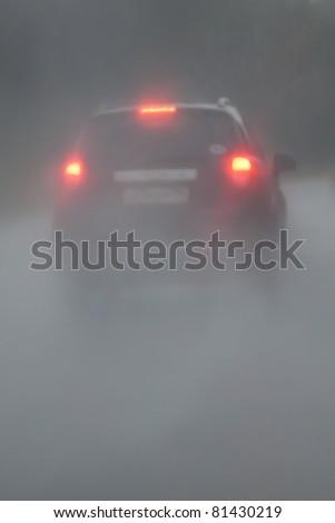 Silhouette of the car in heavy rain