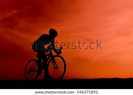 Silhouette of the cyclist riding a road bike at sunset.Mountain bicycle and man.Life style outdoor #546375892