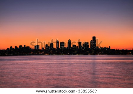 silhouette of the emerald city - Seattle skyline over pre-dawn sky