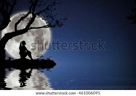 Silhouette of The girl was waiting for someone under the moon.