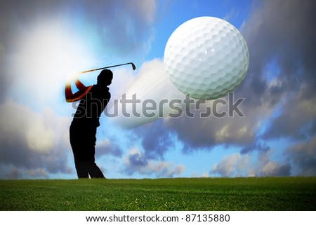 Silhouette of the golfer with flying ball