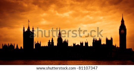 Silhouette of the Houses of Parliament and Big Ben across River Thames in London, UK