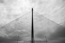 Silhouette of the infamous cable-stayed bridge in Talavera de la Reina over the river Tagus against a cloudy sky, one of the symbols of the real state bubble in Spain.