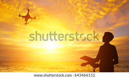 silhouette of the man Control Drone in sunset