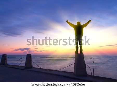 Silhouette of the person on background bright sky during sundown. Abstract composition