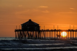 Silhouette of the pier at Huntington Beach in California
