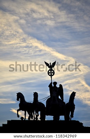 Silhouette of the Quadriga statue on top of the Brandenburg Gate, Berlin, Germany