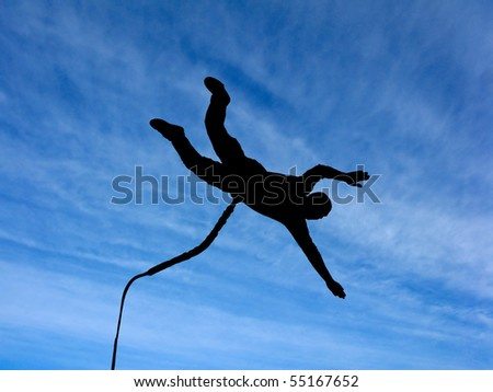Silhouette of the rope-jumper against the sky