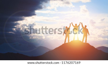 Silhouette of the team on the mountain. Leadership Concept #1176207169