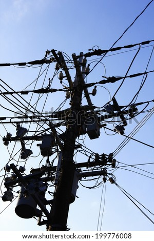 Silhouette Of The Wire And The Utility Pole