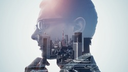 Silhouette of thinking man and modern cityscape. Double exposure.
