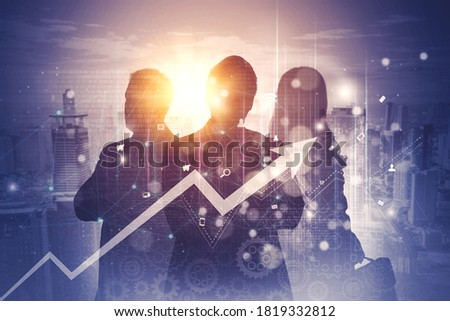 Photo of  Silhouette of three business people standing with double exposure of skyscrapers and upward arrow background