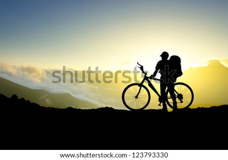 Silhouette of tourist and bike. Sport and active life