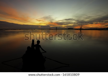 Silhouette of Tourist Boats at U bein